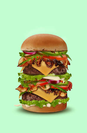 Tasty big double burger against light green background. Ham, beef cutlet, cheese, sauces, vegetables and greens. Close up, copy space 版權商用圖片