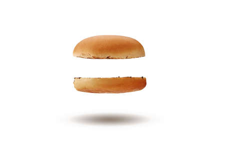 Flying and tasty, baked or grilled, cut in half burger bun isolated on white background. Concept of cooking and fast food. Close-up, copy space 版權商用圖片