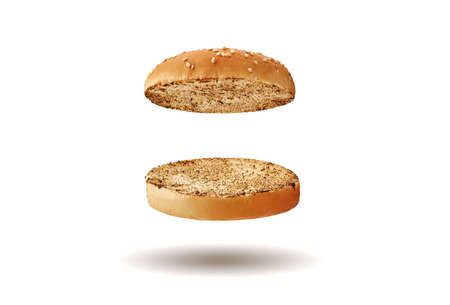 Flying, baked or grilled, cut in half burger bun sprinkled with sesame seeds. Isolated on white. Cooking and fast food. Close-up, copy space