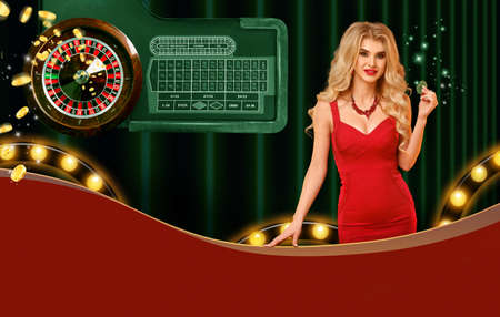 Model in red dress showing green chips, smiling. Posing on colorful background with roulette, flying coins, lights. Copy space. Poker, casino