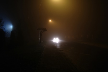 car lights on a street at the night 写真素材