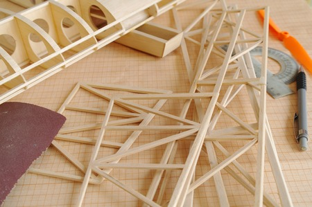 balsa: unfinished RC airplane on the workshop