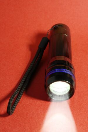 torch light: pocket torch light on a red background