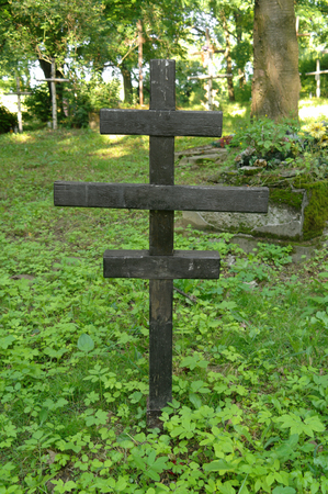 scrub grass: anonymous cross in the old graveyard