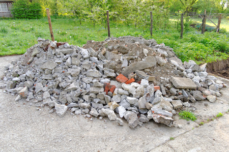 heap: heap of rubble and bricks on the concrete plaza