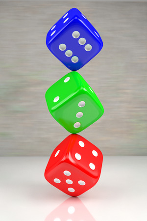red, green and blue dices one on another on the shining plane, 3d rendering