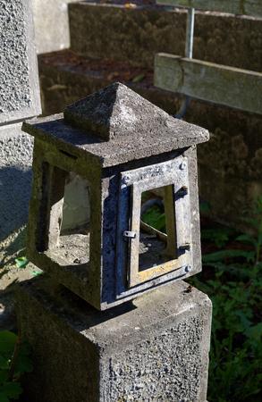 old concrete empty lantern on the grave