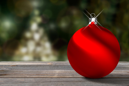 Closeup of a red bauble against the illuminated blurred Christmas tree, 3d rendering