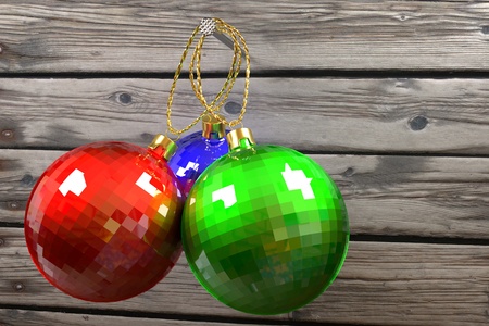 three colorful christmas baubles hanging on nail against the old planks, 3d rendering