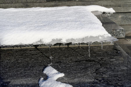 closeup of the melting snow on the black marble 写真素材