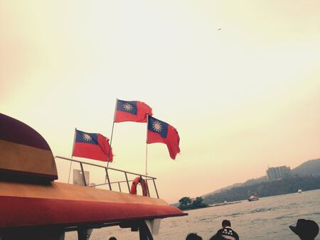 glow: Taiwan flags fluttering in the glow of sunset Stock Photo