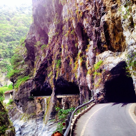 behold: The Tunnel of Nine Turns in Taroko Gorge, Taiwan is an incredible sight to behold. Stock Photo