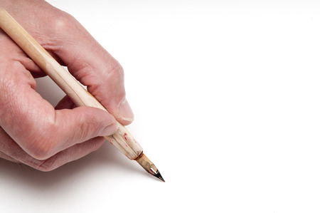 add text: Man using a calligraphy pen with space to add text