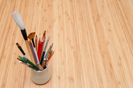 color pencils: Selection of artists tools on a table Stock Photo