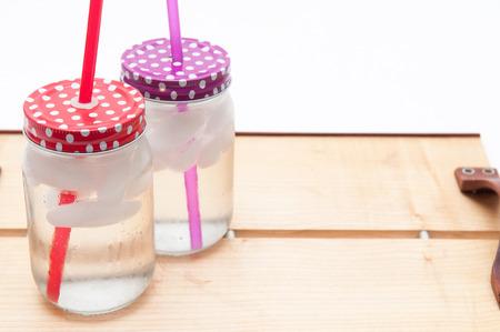 mouth watering: Ice cold drinks of water in jars with colorful lids