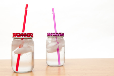 lids: Ice cold drinks of water in jars with colorful lids
