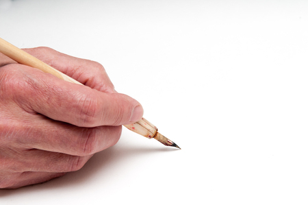 calligraphy pen: Man using a calligraphy pen with space to add text