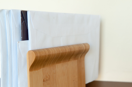 summons: Unopened mail pilied up on the shelf