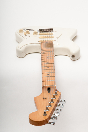 amp: Electric guitar on a bright white plain background