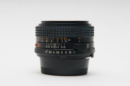 millimetre: Vintage style anaolg fifty millimetre prime lens on a white backgound