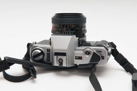 viewfinder vintage: old vintage style film camera on a white background