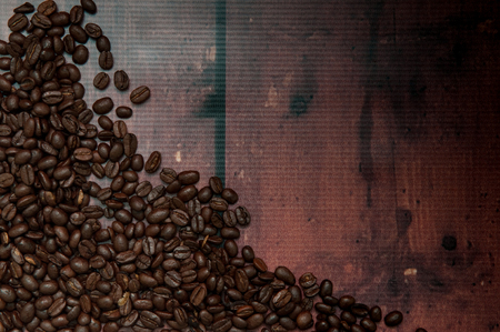 heaped: A frame full of coffee beans for a useful drinks background Stock Photo
