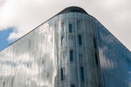 refelction: Sky and clouds being reflected on the side of a glass building Stock Photo