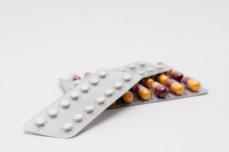 medicated: Tablets and capsules of medicine on a white background Stock Photo