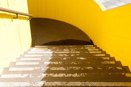 stair well: Set of car park stairs with a shadow being cast across them