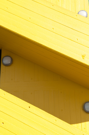 stair well: Modern yellow stairway exterior to a carpark