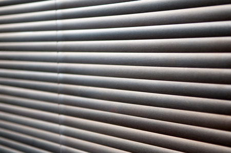 blinds: Morning sun shing through closed wooden blinds Stock Photo