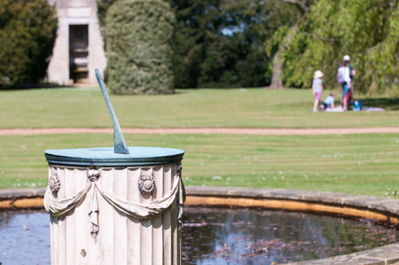 sun dial: Sundial in the grounds of a garden in bright sunlight Stock Photo