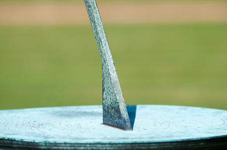 sundial: Sundial in the grounds of a garden in bright sunlight Stock Photo