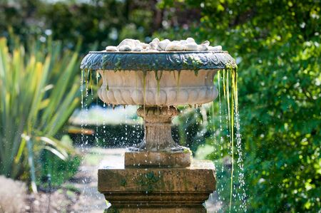 water garden: Close up of cool refreshing water splashing from a garden fountain Stock Photo