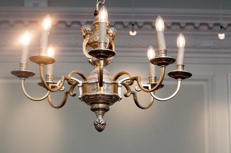 vintage chandelier: Ornate vintage chandelier light hanging from the ceiling