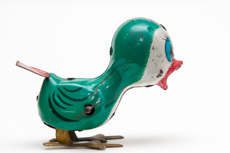 tweeting: Vintage tweeting toy bird, ideal for different social media logo for retro web page Stock Photo