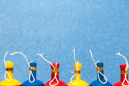 poppers: Colorful party poppers arranged in a row on a bright background
