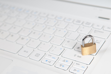 laptop computer being protected from online cyber crime and hacking