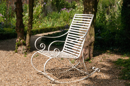 seating area: Garden furniture. Bench in a seating area of a formal garden