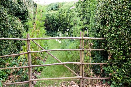 formal garden: Entrance to a maze in a formal garden with a closed gate