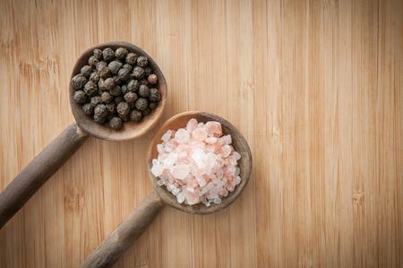 rock salt: Salt and pepper seasonings of pepper corns and rock salt on wooden spoons
