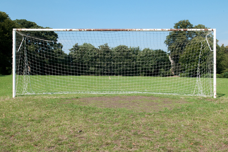 pitch: Football pitch goal posts and net on a soccer pitch Stock Photo