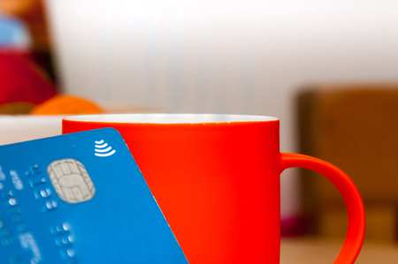 Using contactless payment card to buy a coffee