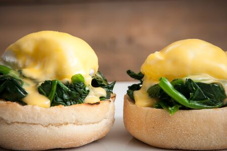 Eggs benedict or eggs florentine on a white plate Stock Photo