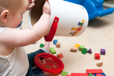 learning new skills: baby playing with blocks and sorting shapes