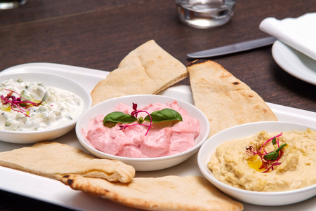 restaurant starter meal of a sharing platter of dips with bread Stock Photo