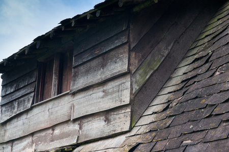 run down: Old derelict wooden house, roof detail