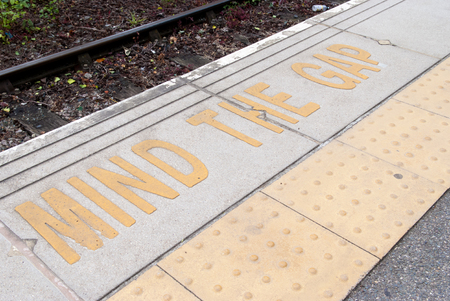 edges: Platform edge at the train station with safety warning