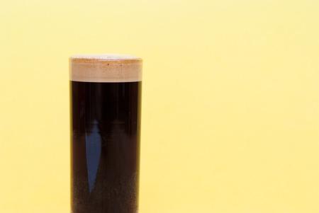 crema: espresso. double shot of espresso in a tall coffee glass on bright background