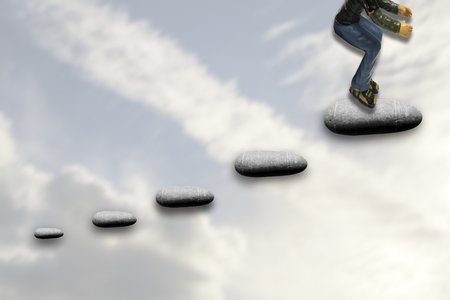 Successful man climbs stepping stones to success Stock Photo